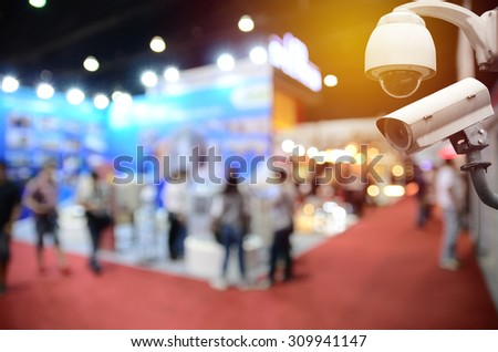 Surveillance Security Camera or CCTV in event hall - stock photo
