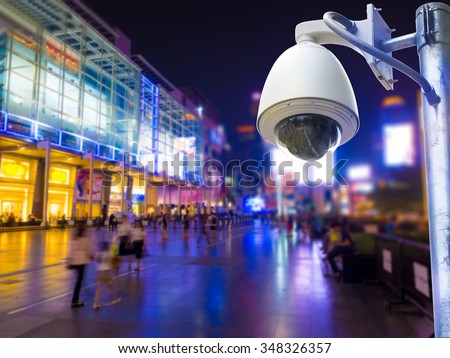 Surveillance Security Camera or CCTV installed outdoor in shopping mall,  - stock photo