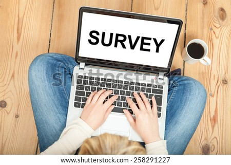survey written on laptop for market research - stock photo