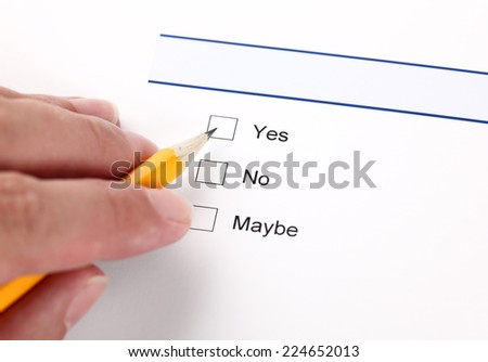 Survey: yes, no, maybe, and human hand with pencil - stock photo