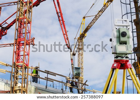 surveying and construction cranes - stock photo