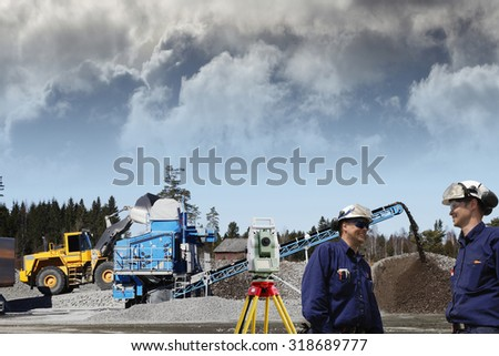 surveying engineers, workers with measuring instrument inside construction-site - stock photo