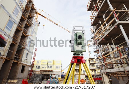 surveying measuring instrument inside construction plant - stock photo