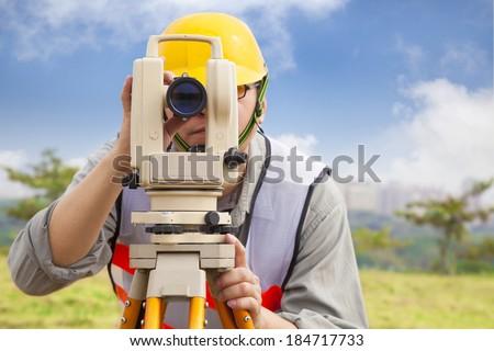 Surveyor engineer making measure in outdoor - stock photo