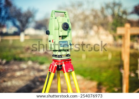 surveyor engineering equipment with theodolite and total station at a construction site - stock photo