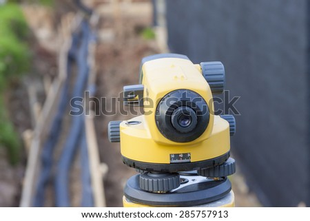Surveyor equipment optical level at construction site - stock photo