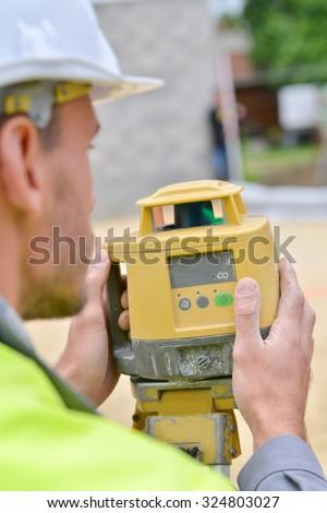 Surveyor taking a measurement - stock photo