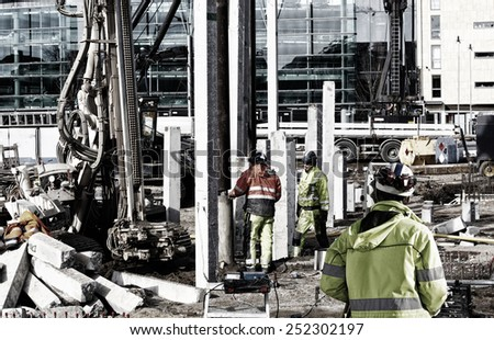 surveyors and workers inside construction plant - stock photo