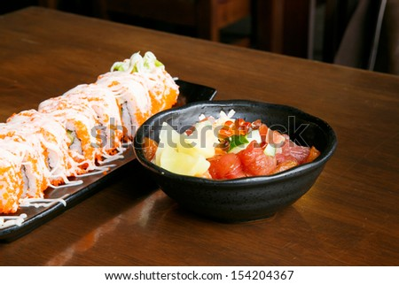 Sushi and salmon in black bowl - stock photo