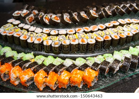 Sushi are arranged on the curve plate - stock photo