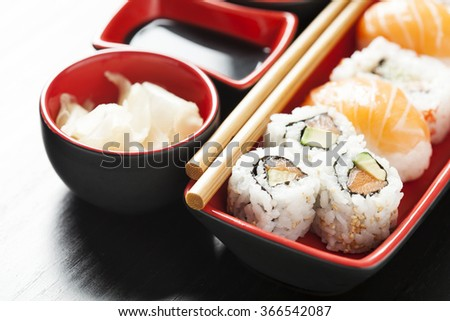 Sushi assortment on plate with chopsticks - stock photo