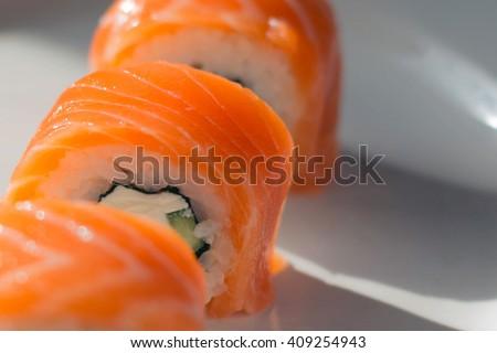 Sushi. Close up of tasty fresh sushi rolls on plate. Sushi roll japanese food - stock photo