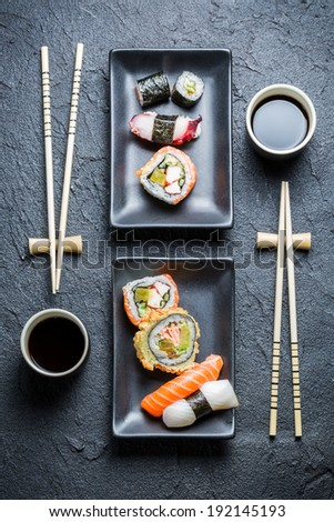 Sushi for two served in a black ceramic - stock photo