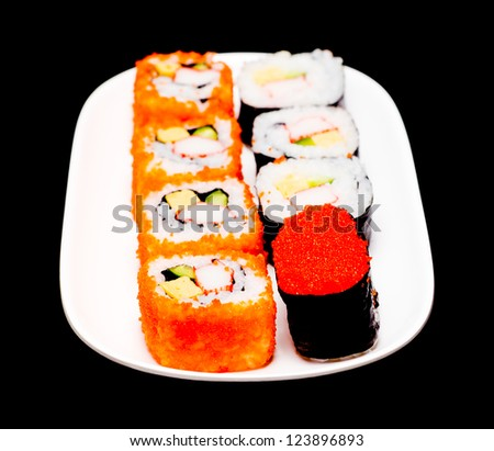 sushi in white plate on black background with shallow DOF - stock photo