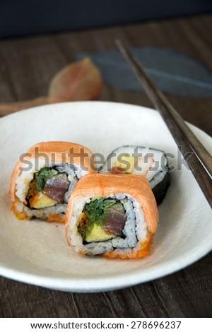 sushi japanese food on white dish - stock photo