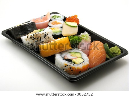 Sushi lunch with salmon, scallop and more in a box for takeout, on white. - stock photo