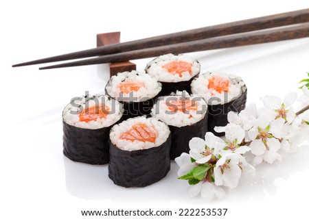 Sushi maki set and sakura branch. Isolated on white background - stock photo