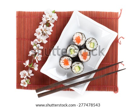 Sushi maki set with salmon and cucumber and sakura branch. Isolated on white background - stock photo