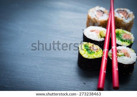 Sushi on a black - stock photo