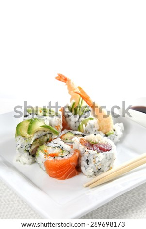Sushi on a white plate, shallow focus - stock photo