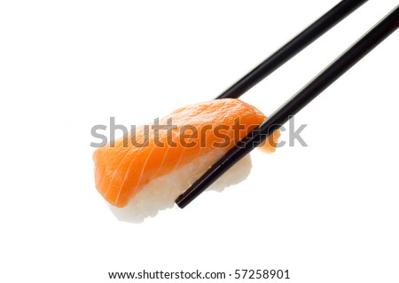sushi on chopstick - stock photo