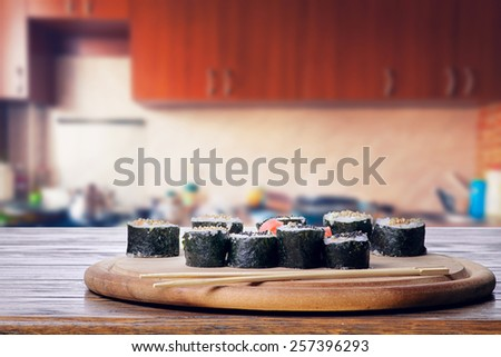 Sushi on the kitchen table - stock photo