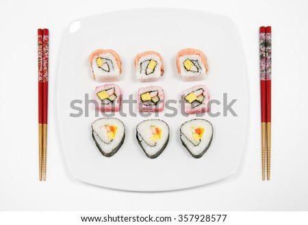 Sushi on White Plate With Chopsticks - stock photo