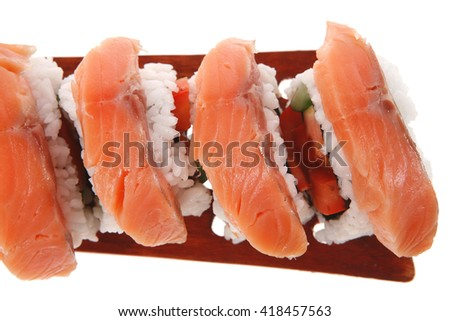 sushi onigiri inside out californian rolls on wooden paddle isolated on white background - stock photo