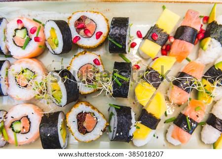 Sushi plate. Sushi food. Various kinds of sushi food. - stock photo