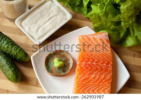 Sushi prepared with rice, raw tune, raw salmon, wasabi sauce, majo, soya sauce, prawn and avocado, lettuce rice . You can find it at japanese restaurant. Japan, japanese food, Asia - stock photo