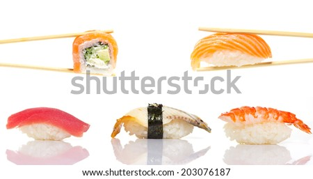 Sushi roll and nigiri in chopsticks isolated - stock photo