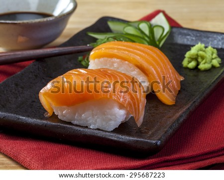 Sushi roll on white plate, closeup - stock photo