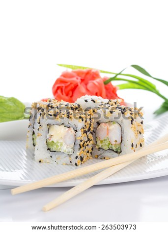 Sushi roll on white plate with ginger and wasabi - stock photo