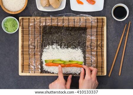 sushi roll process of making raw makki fresh seafood susi - stock image - stock photo
