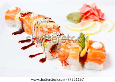 Sushi Roll with salmon, eel, tiger shrimp, tobiko caviar, avocado and ...