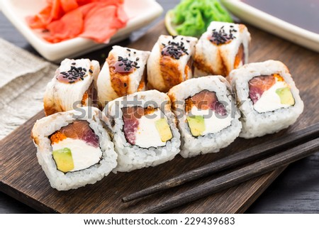 Sushi roll with salmon, tuna and eel - stock photo
