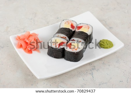Sushi rolls made of crab meat, cheese, and tomato - stock photo