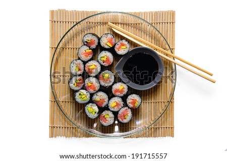 Sushi rolls on a plate with chopsticks and soy sauce, top view - stock photo