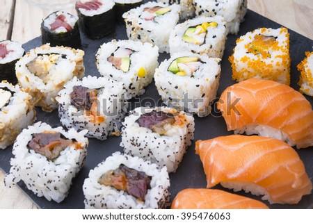 Sushi rolls on a slate plate - stock photo