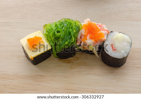 Sushi rolls  on a wooden plate,Japanese food - stock photo