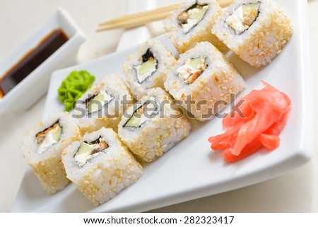 sushi rolls, soy sauce chopsticks on the marble countertop - stock photo