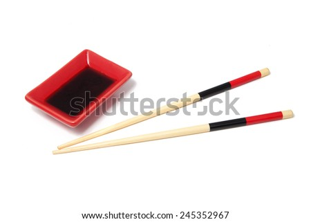 Sushi saucer and wooden chopsticks isolated over white - stock photo
