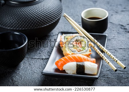 Sushi served with tea - stock photo