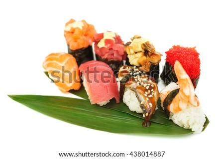 Sushi set assorrted rolls on solated on white background - stock photo