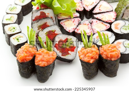 Sushi Set - Different Types of Maki Sushi and Nigiri Sushi. Served on Green Leaves - stock photo