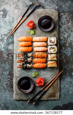 Sushi Set for two served on gray stone slate on metal background - stock photo