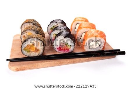 sushi set in a kitchen board, isolated on white - stock photo