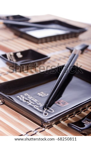 Sushi set of cups and chopstick. Selective focus. - stock photo