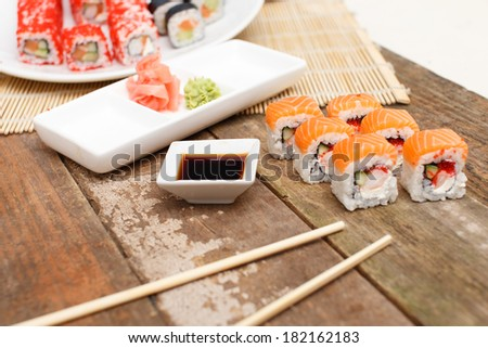 Sushi set on the table with a plate and a bowl - stock photo