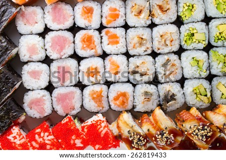 Sushi set with many fresh and tasty ingredients - stock photo